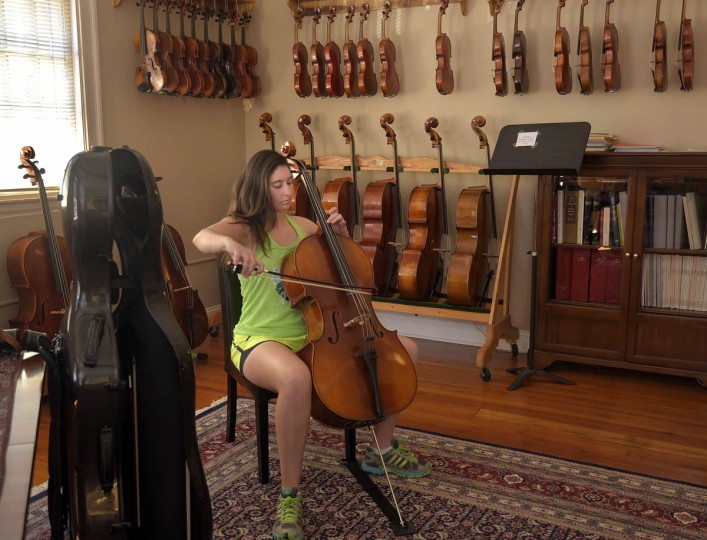 Katherine Jeffreys, 20, from Parkton, MD who is in the market for a new bow, plays her cello with one of the new bows she's considering at Perrin and Associates Fine Violins, founded in 1994. (Algerina Perna/Baltimore Sun)