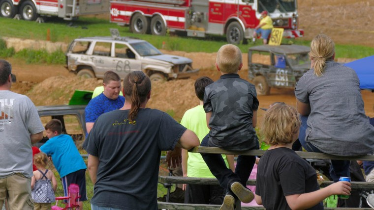 Spectators observe SUVs and Jeeps race during Demo Derby Day at Arcadia Volunteer Fire Company's carnival grounds. (Karl Merton Ferron/Baltimore Sun)