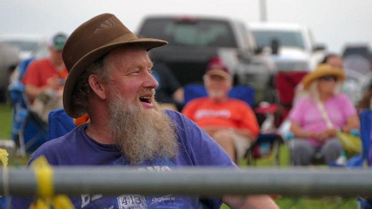Tom Becke of Manchester, MD smiles while watching the races during Demo Derby Day at Arcadia Volunteer Fire Company's carnival grounds. (Karl Merton Ferron/Baltimore Sun)
