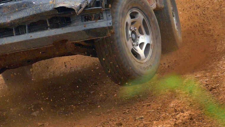 Wheels lift off the ground while soil and gravel kick about in a race during Demo Derby Day at Arcadia Volunteer Fire Company's carnival grounds. (Karl Merton Ferron/Baltimore Sun)