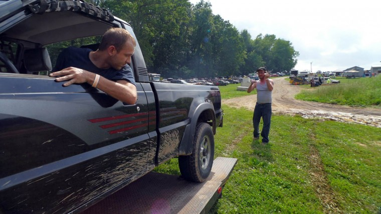Keith Stamm of Gettysburg (left) backs a pickup from the trailer as Darryl Kump of Gettysburg motions during Demo Derby Day at Arcadia Volunteer Fire Company's carnival grounds. (Karl Merton Ferron/Baltimore Sun)