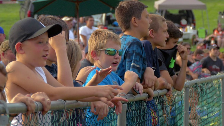 Spectators watch the action, safely from behind the fence during Demo Derby Day at Arcadia Volunteer Fire Company's carnival grounds. (Karl Merton Ferron/Baltimore Sun)