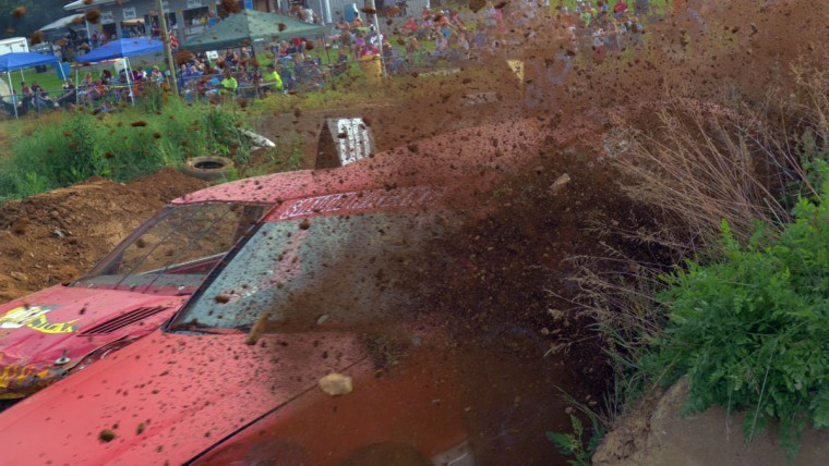 One car kicks up dirt and rocks while being forced to the outside of a turn during Demo Derby Day at Arcadia Volunteer Fire Company's carnival grounds. (Karl Merton Ferron/Baltimore Sun)