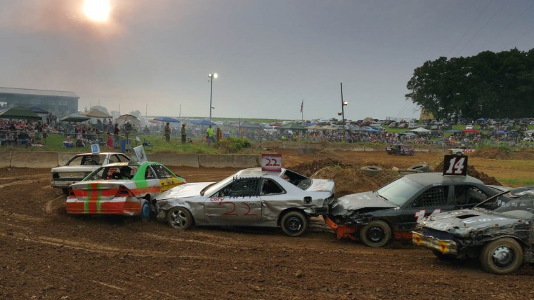 Passenger cars hit each other while they both make a sharp right turn in their race during Demo Derby Day at Arcadia Volunteer Fire Company's carnival grounds. (Karl Merton Ferron/Baltimore Sun)
