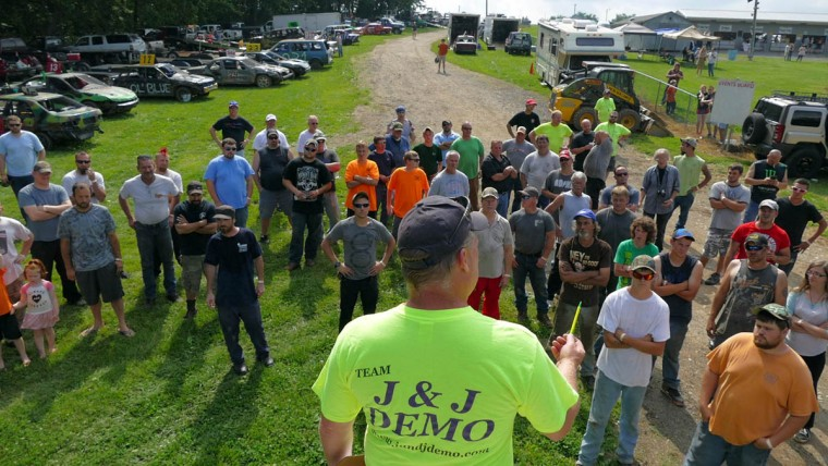 Drivers listen to pre-race safety and rules during Demo Derby Day at Arcadia Volunteer Fire Company's carnival grounds. (Karl Merton Ferron/Baltimore Sun)
