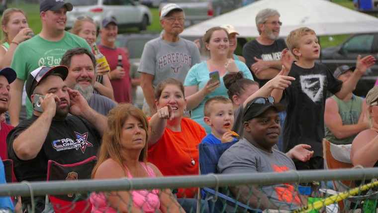 People watch the mayhem unfold during Demo Derby Day at Arcadia Volunteer Fire Company's carnival grounds. (Karl Merton Ferron/Baltimore Sun)