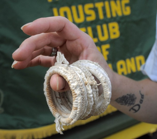 A stack of inch and three-quarter rings wrapped in white cords. (Kenneth K. Lam, Baltimore Sun)