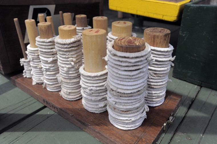Stacks of different sized white cord wrapped rings used for ring jousting. (Kenneth K. Lam, Baltimore Sun)