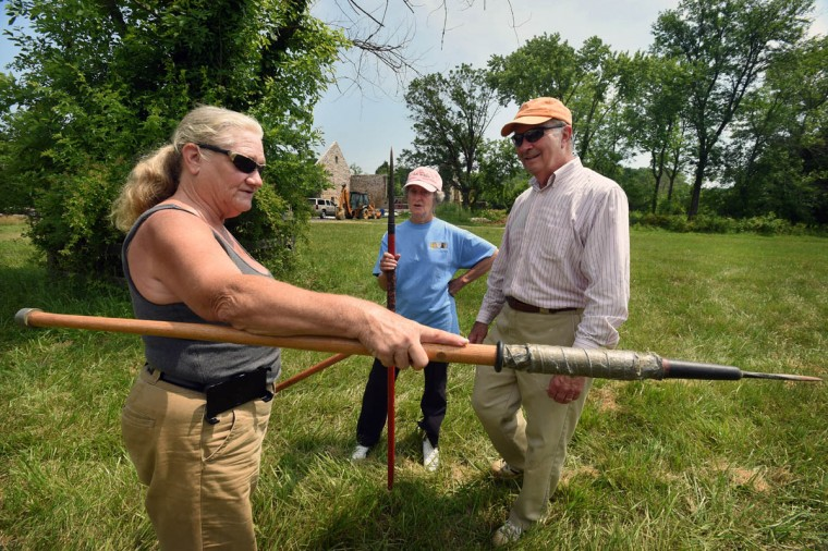 Former ring jouster Amy Kreutzer, left, of Delta, Pa., shows different lances used for ring jousting to Frank and Stephanie Duchacek, of Kingsville, during Amateur Jousting Club of Maryland's 2016 Founder's Day Joust at the historic Jerusalem Mill Village. (Kenneth K. Lam, Baltimore Sun)