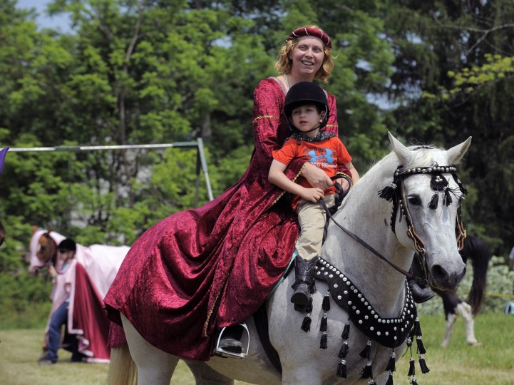 Nicole Barnett, of Nottingham, dressed in replica medieval dress parade with her son Luke Solomon, 4, before Amateur Jousting Club of Maryland's 2016 Founder's Day Joust at the historic Jerusalem Mill Village. (Kenneth K. Lam, Baltimore Sun)