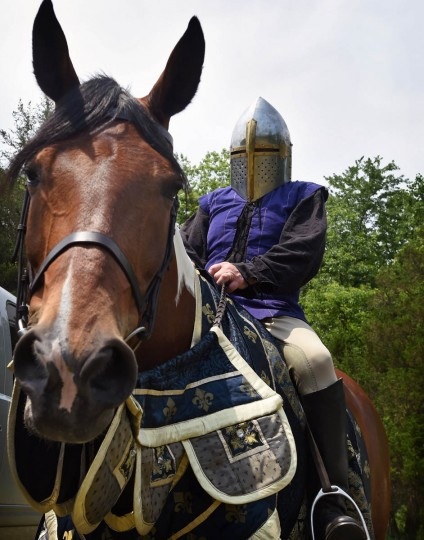 John Angevine, of Chevy Chase, wears a knight's helmet for the parade during Amateur Jousting Club of Maryland's 2016 Founder's Day Joust. (Kenneth K. Lam, Baltimore Sun)