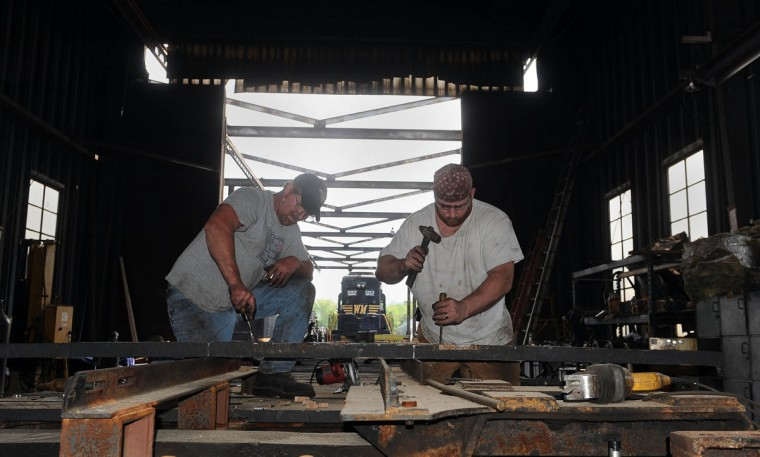 Bruce Snyder, left, mechanic, and Scott Nixon, right, shop foreman, work on installing new boards on the tender frame of the C & O railroad 1309 steam locomotive at the Western Maryland Scenic Railroad yard, where restoration work is being done on the train. When the restoration is complete, probably next year, the locomotive will pull passenger cars along the scenic railroad between Cumberland and Frostburg. (Barbara Haddock Taylor, Baltimore Sun)