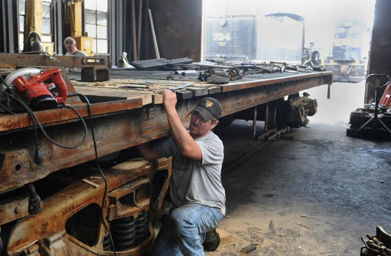 Bruce Snyder, a mechanic with Western Maryland Scenic Railroad, installs boards on the tender frame of the C & O railroad 1309 steam locomotive at the Western Maryland Scenic Railroad yard, where restoration work is being done on the train. When the restoration is complete, probably next year, the coal-powered locomotive will pull passenger cars on the scenic railroad on its route between Cumberland and Frostburg. (Barbara Haddock Taylor, Baltimore Sun)