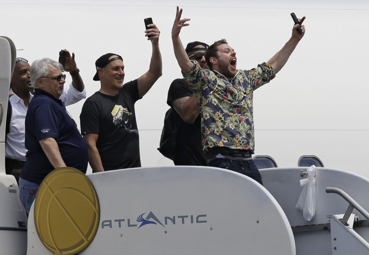 Cleveland Cavaliers' Matthew Dellavedova, from Australia, yells to fans after arriving in Cleveland, Monday, June 20, 2016. The Cavaliers defeated Golden State in Game 7 of the NBA Finals on Sunday in Oakland, Calif. (AP Photo/Tony Dejak)