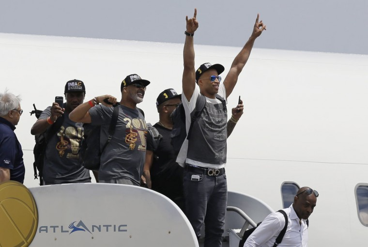 Cleveland Cavaliers' Richard Jefferson raises his arms in celebration after arriving in Cleveland, Monday, June 20, 2016. The Cavaliers defeated Golden State in Game 7 of the NBA Finals on Sunday in Oakland, Calif. (AP Photo/Tony Dejak)