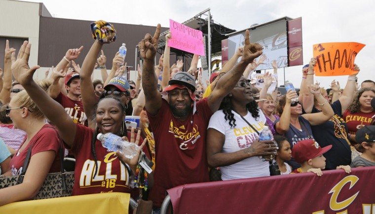 Cleveland Cavaliers fans celebrate as they wait for the team's arrival in Cleveland, Monday, June 20, 2016. LeBron James came home with the trophy he promised, and the championship Cleveland has coveted for 52 years. The NBA superstar, born and raised in nearby Akron, stepped off a plane Monday and hoisted the shiny Larry O'Brien Trophy as more than 10,000 fans celebrated the city's first title since 1964. (AP Photo/Tony Dejak)