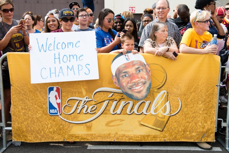 Fans greet the Cleveland Cavaliers players returning to Cleveland after winning the NBA Championship on June 20, 2016 in Cleveland, Ohio. (Photo by Jason Miller/Getty Images)