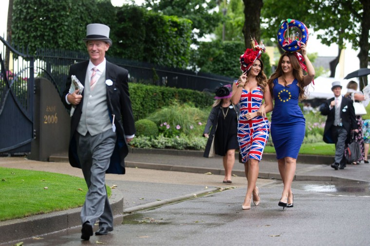 Models promoting betting for a bookmaker for the upcoming EU referendum pose for photographers on the first day on the first day of the Royal Ascot horse racing meet, in Ascot, west of London, on June 14, 2016. (JUSTIN TALLIS/AFP/Getty Images)