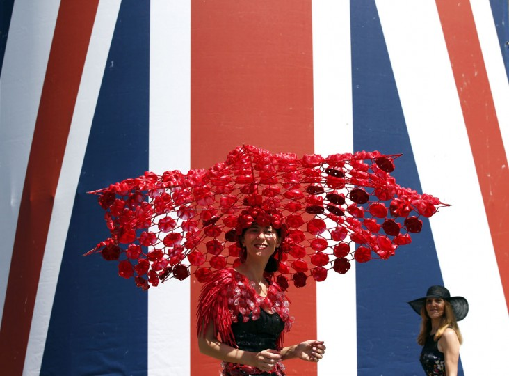 Larisa Katz poses for a photograph during Ladies' day at Royal Ascot, in Berkshire, west of London, on June 18, 2015. The five-day meeting is one of the highlights of the horse racing calendar. Horse racing has been held at the famous Berkshire course since 1711 and tradition is a hallmark of the meeting. Top hats and tails remain compulsory in parts of the course while a daily procession of horse-drawn carriages brings the Queen to the course. (ADRIAN DENNIS/AFP/Getty Images)