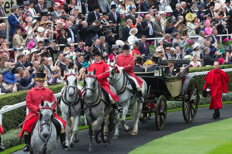 Britain's Queen Elizabeth II and Britain's Prince Philip, Duke of Edinburgh arrive for the first day of the Royal Ascot horse racing meet in Ascot, west of London on June 14, 2016. (JUSTIN TALLIS/AFP/Getty Images)