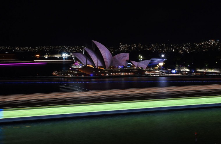 Light trails from boats during a long exposure are seen as Australia's iconic Opera House is lit up for the Vivid Sydney festival on June 1, 2016. Vivid Sydney, an annual festival of light, music and ideas, runs from May 27 to June 18. (SAEED KHAN/AFP/Getty Images)