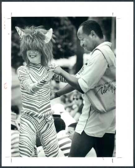 ARTSCAPE VIEWS--Dancing in the streets on Mount Royal avenue-Marcus MacKinnon of Baltimore dances with Annie Hickman of a street theatre group of New York City dressed as a red zebra. 1992. (Sandor/Baltimore Sun)