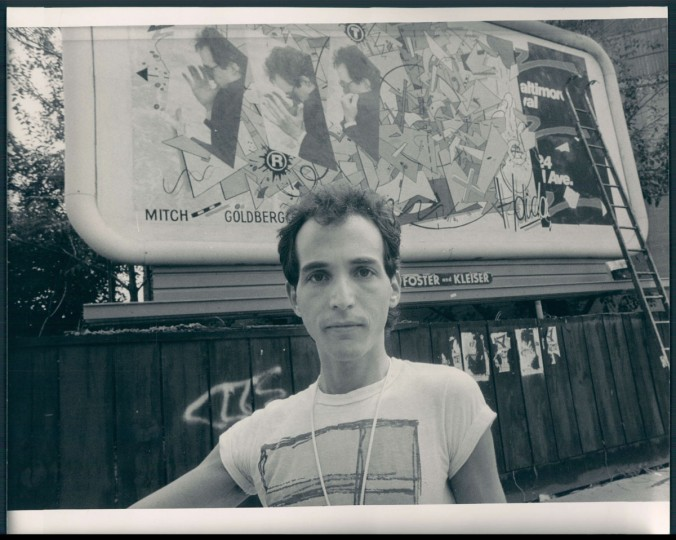 Mitch Goldberg and his Artscape billboard. 1983. (Phillips/Baltimore Sun)