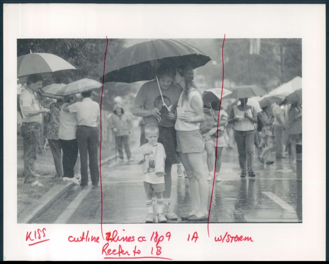 Paul Rossbach, being whispered to in the rain by Heather Conner, and Paul Rossbach, Jr. 1990. (Phillips/Baltimore Sun)