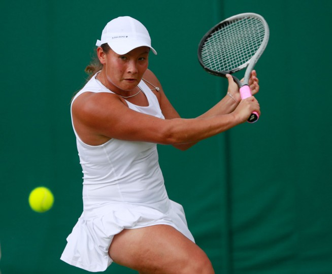 Tara Moore of Great Britain plays a backhand during the Ladies Singles second round match against Svetlana Kuznetsova of Russia on day five of the Wimbledon Lawn Tennis Championships at the All England Lawn Tennis and Croquet Club on July 1, 2016 in London, England. (Photo by Adam Pretty/Getty Images)