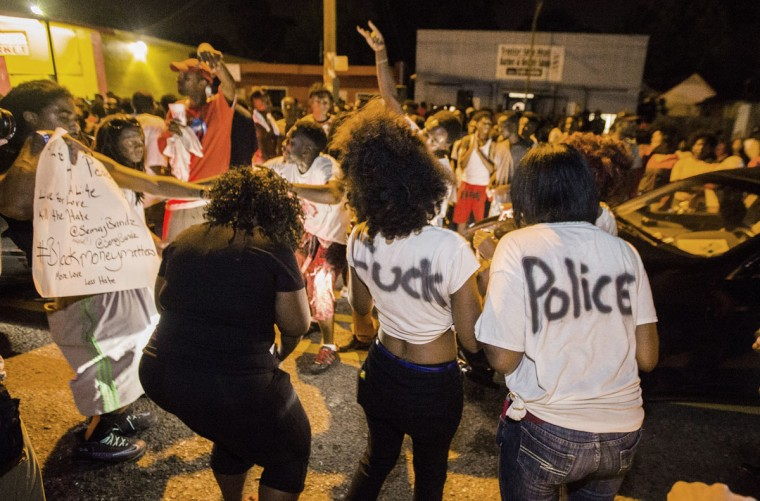 Protesters dance in the street near the convenience store where Alton Sterling was shot and killed, July 6, 2016 in Baton Rouge, Louisiana. Sterling was shot by a police officer in front of the Triple S Food Mart in Baton Rouge on Tuesday, July 5, leading the Department of Justice to open a civil rights investigation. (Photo by Mark Wallheiser/Getty Images) (Photo by Mark Wallheiser/Getty Images)