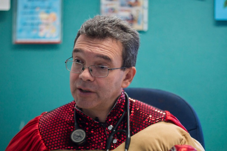 Mexican pediatric oncologist Sergio Gallegos, disguised as a traditional Mexican wrestler, speaks during an interview with AFP at a hospital in Guadalajara, Mexico on July 12, 2016. Gallegos believes the mood of his patients is very important for the success of cancer treatment, so he disguises as different characters. (HECTOR GUERRERO/AFP/Getty Images)