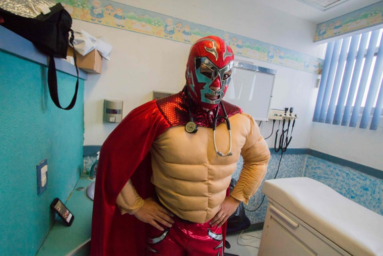 Mexican pediatric oncologist Sergio Gallegos, disguised as a traditional Mexican wrestler, poses during an interview with AFP at a hospital in Guadalajara, Mexico on July 12, 2016. Gallegos believes the mood of his patients is very important for the success of cancer treatment, so he disguises as different characters. (HECTOR GUERRERO/AFP/Getty Images)