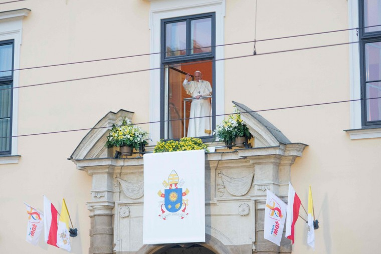 Pope Francis greets the crowd from the Papal window on July 28, 2016, in Krakow as part of his visit to the World Youth Days. ( BARTOSZ SIEDLIK/AFP/Getty Images)