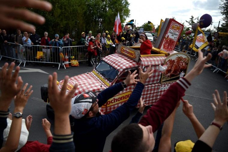 A vehicle of French brand of dry sausage Cochonou participates in a publicity caravan parade prior to the start of the 188 km first stage of the 103rd edition of the Tour de France cycling race on July 2, 2016 between Mont-Saint-Michel and Utah Beach Sainte-Marie-du-Mont, Normandy. The 2016 Tour de France will start on July 2 in the streets of Le Mont-Saint-Michel and ends on July 24, 2016 down the Champs-Elysees in Paris. (AFP Photo/Lionel )
