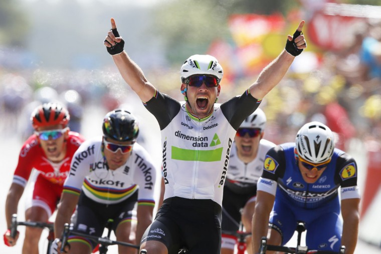 Britain's sprinter Mark Cavendish crosses the finish line ahead of Peter Sagan of Slovakia, second left, and Germany's sprinter Marcel Kittel, right, to win the first stage of the Tour de France cycling race over 188 kilometers (116.8 miles) with start in Mont-Saint-Michel and finish in Utah Beach, France, Saturday, July 2, 2016. (AP Photo/Peter Dejong)