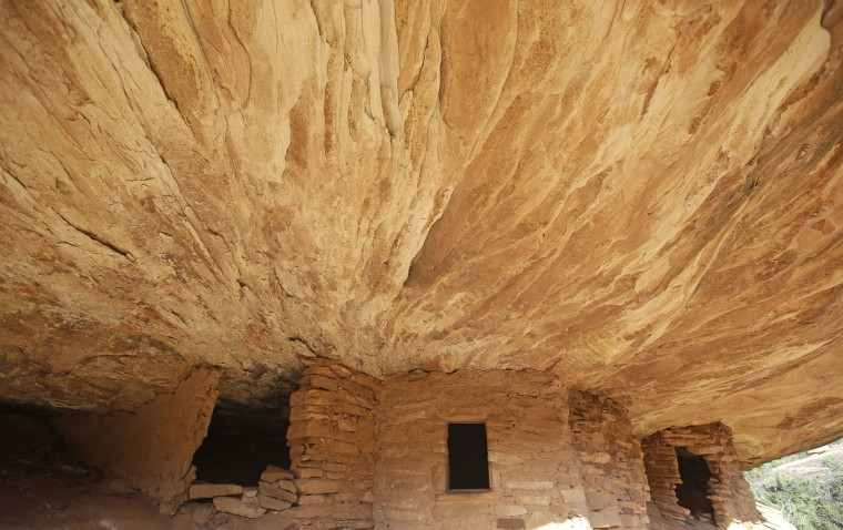 "This June 22, 2016, photo, the ""House on Fire"" ruins are shown in Mule Canyon, near Blanding, Utah. These Anasazi ruins are found along a canyon hiking path in a dry river bed. They are one of an estimated 100,000 archaeological sites within a 1.9-million acre area of Utah's red rock country that a coalition of American Indian tribes and environmentalists want President Barack Obama to designate as a national monument to ensure protections of lands considered sacred. (AP Photo/Rick Bowmer)"