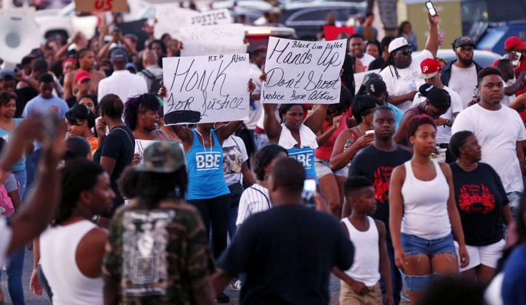 Protestors from the Triple S convenience store in Baton Rouge, La., Wednesday, July 6, 2016. Alton Sterling, 37, was shot and killed outside the store by Baton Rouge police, where he was selling CDs. (AP Photo/Gerald Herbert)