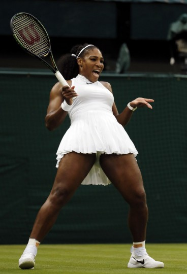 Serena Williams of the U.S reacts as she plays Christina McHale of the U.S during their women's singles match on day five of the Wimbledon Tennis Championships in London, Friday, July 1, 2016. (AP Photo/Ben Curtis)