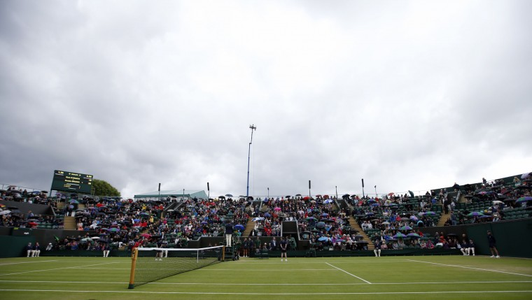 Dark clouds are seen over court 2 as rain delays play on day five of the Wimbledon Tennis Championships in London, Friday, July 1, 2016. (AP Photo/Alastair Grant)