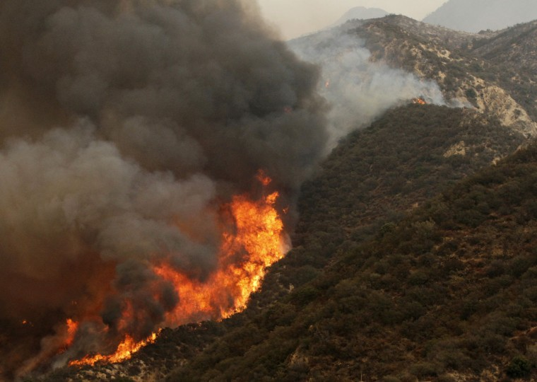 The Sand Fire burns near Wildlife Waystation on Little Tujunga Canyon Road on Saturday, July 23, 2016. (Katharine Lotze/The Santa Clarita Valley Signal via AP)