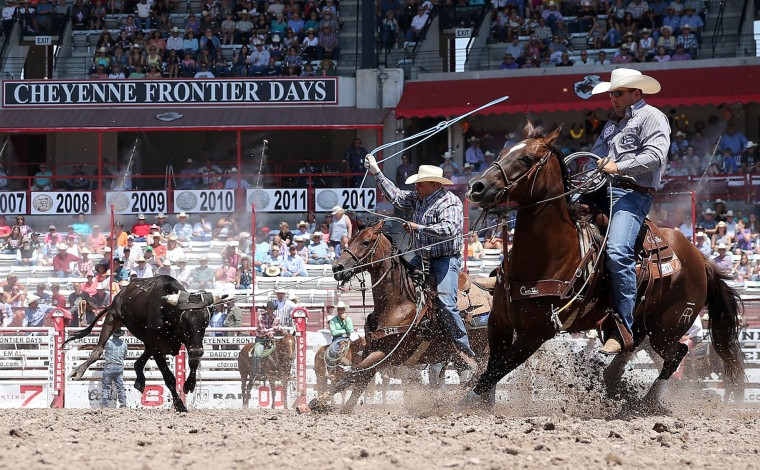 Adam Rose and Walt Woodard compete in the team roping event during the fifth day of the 120th annual Cheyenne Frontier Days Rodeo Wednesday, July 27, 2016, at Frontier Park Arena in Cheyenne, Wyo. (Blaine McCartney/The Wyoming Tribune Eagle via AP)
