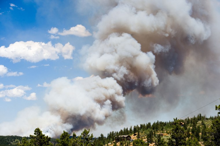 The fire continues to burn in Cold Springs near Nederland, Colo. on Sunday, July 10, 2016. (Autumn Parry/The Daily Camera via AP)