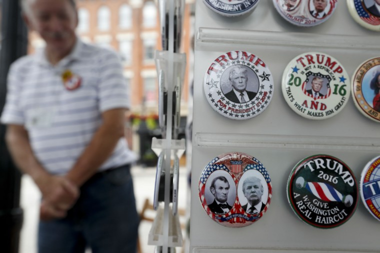 Bob Alexander poses with his custom campaign buttons for Republican presidential candidate Donald Trump on Monday, July 18, 2016, in Cleveland. The Republican National Convention starts today. (AP Photo/Alex Brandon)