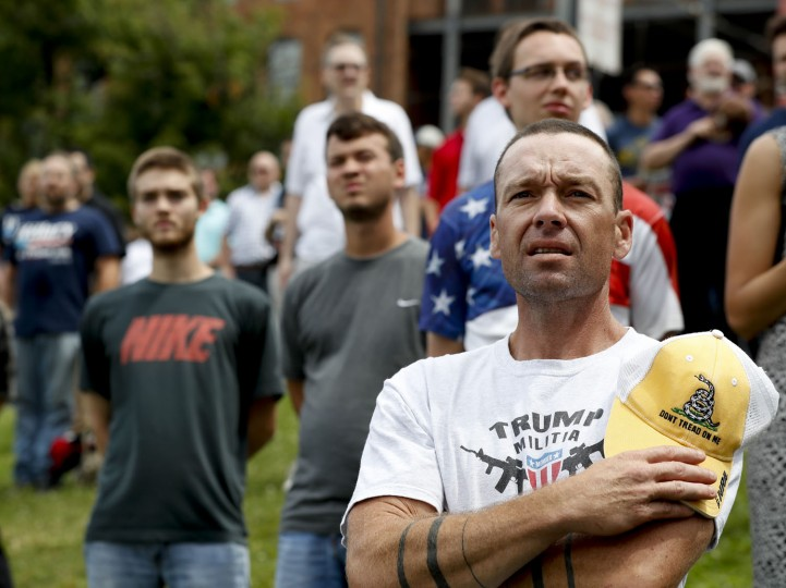 Supporters listen during the national anthem during a rally for Republican presidential candidate Donald Trump at Settlers Landing Park on Monday, July 18, 2016, in Cleveland. The Republican National Convention starts today. (AP Photo/Alex Brandon)