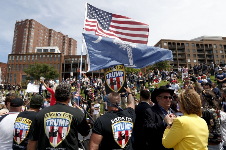 Members of the group Bikers for Trump watch during a rally for Republican presidential candidate Donald Trump at Settlers Landing Park on Monday, July 18, 2016, in Cleveland. The Republican National Convention that starts today. (AP Photo/John Minchillo)