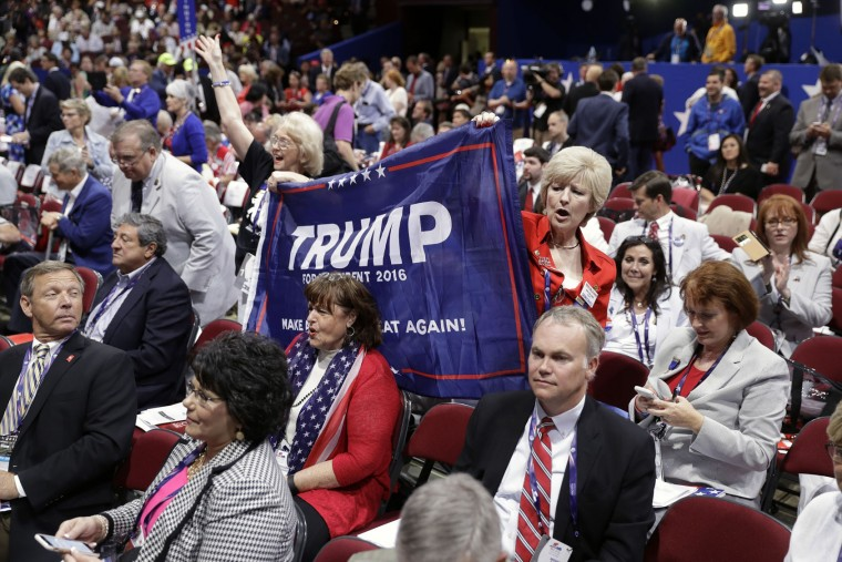 Trump supporters Kay Kellogg Katz, left, and Gena Gore from Monroe, La., cheer during first day of the Republican National Convention in Cleveland, Monday, July 18, 2016. (AP Photo/Matt Rourke)