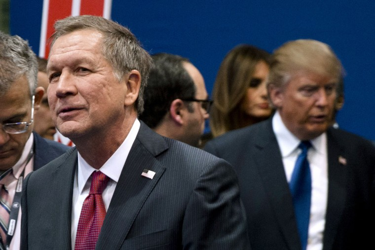 "FILE - In this Feb. 6, 2016, file photo, Ohio Gov. John Kasich, left, and Donald Trump, right, speak to reporters after a Republican presidential primary debate hosted by ABC News at Saint Anselm College in Manchester, N.H. Donald Trump's top campaign adviser accused Ohio Gov. John Kasich of ""embarrassing"" his home state by avoiding the Republican convention, opening the gathering with a stark display of party disunity. (AP Photo/Matt Rourke, File)"