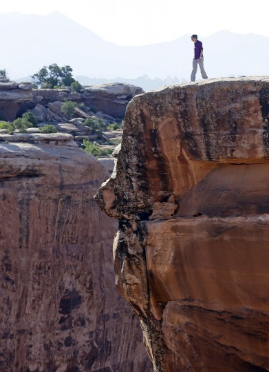 "U.S. Interior Secretary Sally Jewell looks in to a canyon at Gemini Bridges during a tour Thursday, July 14, 2016, near Moab, Utah. Jewell is visiting the area this week to meet with proponents and opponents the latest indication the Obama administration is giving serious consideration to the ""Bears Ears"" monument proposal. The issue has become the latest battleground in the debate over public lands in the West. (AP Photo/Rick Bowmer)"