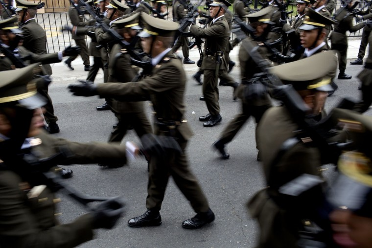 Policemen practice their parade routine before the start of a military parade to mark the country's Independence Day in Lima, Peru, Friday, July 29, 2016. Peru declared it's independence from Spain on July 28, 1821. (AP Photo/Rodrigo Abd)