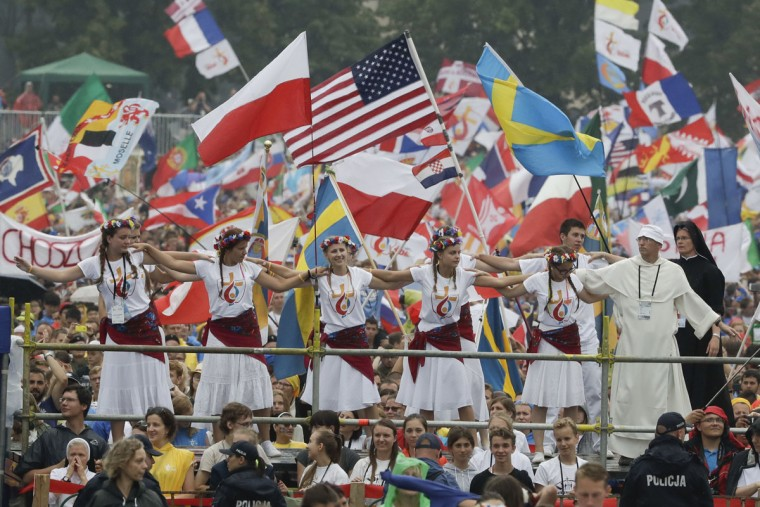 Faithful participating in World Youth Days wait for the arrival of Pope Francis at Jordan Park in Krakow, Poland, July 28, 2016. (AP Photo/Gregorio Borgia)
